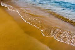 Wave. Sandy seacoast in summer day Stock Image