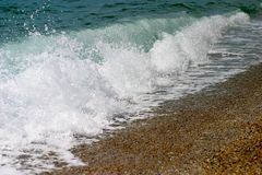 Wave. A wave breaking on a beach Royalty Free Stock Photo