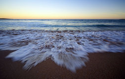 Wave. Incoming ocean wave in motion after sunset Royalty Free Stock Photos
