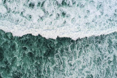 Wave from above. Aerial view of a magnificent ocean wave Stock Photos
