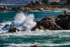 Wave Action. Pacific Grove, California - USA; February 20, 2018; Located between Monterey and Pebble Beach, visitors and residents to Pacific Grove enjoy Royalty Free Stock Photo