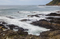Wave action on a rugged coast line Stock Images