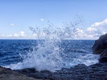 Wave bangs on the rocks royalty free stock photography