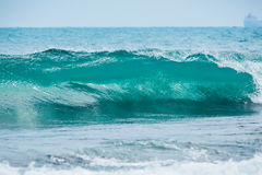 Wave barrel crashing and clear water. Blue wave in tropical ocean. royalty free stock photography