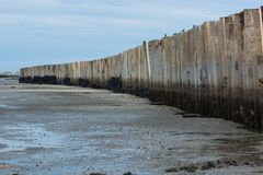 Wave barrier on beach at Phetchaburi Province, Thailand. stock photography