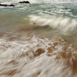 Wave at the beach. Captured with slow shutter speed Royalty Free Stock Photo