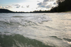 Wave on beach in evening Royalty Free Stock Photo