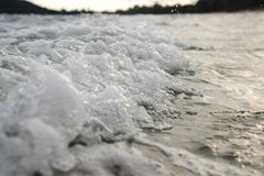 Wave on beach in evening Stock Photography