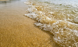 Wave on the Beach. Wave from incoming tide on the beach Royalty Free Stock Images