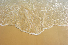 Wave and beach sand Royalty Free Stock Image