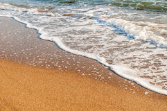 Wave on the beach Stock Images