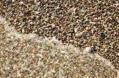 Wave on the beach Stock Photos