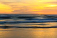 Wave on the beach. Slow speed sea wave at sunset time, Parangtritis Beach, Jogjakarta, Indonesia Royalty Free Stock Photos