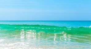 Wave on beautiful summer beach and tropical sea.  Stock Images