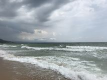 Wave at Black Sea coast. With stormy clouds in background royalty free stock images