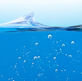 Wave blue liquid with air bubbles Royalty Free Stock Photo