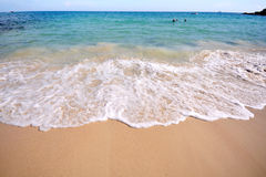 The wave from the blue sea on sands. The wave from the blue sea on yellow sands Stock Photos