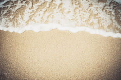 Wave of blue sea. On sandy beach vintage style stock image