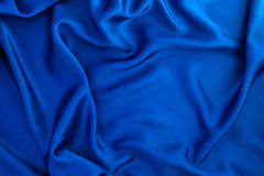 Wave blue silk or satin fabric background Stock Photos
