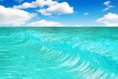 Wave on blue sky background Royalty Free Stock Photo