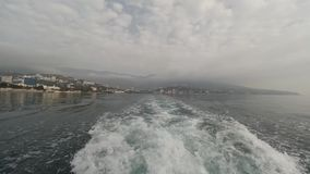 Wave from the boat. View of the city from the boat stock footage