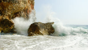 Wave brakes on rocks Stock Images