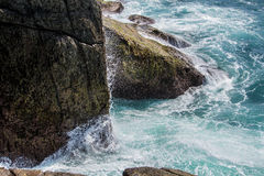 Wave break against the rock, horizontal Royalty Free Stock Photo