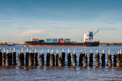 Wave breaker and Cargo Ship Royalty Free Stock Image