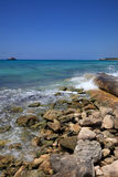 Wave breaker on the caribbean coast Stock Photos