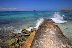 Wave breaker on the caribbean coast Royalty Free Stock Photo