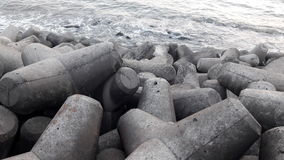 Wave breaker at Haji Ali Creek, Mumbai India. Wave breaker during low tide at Haji Ali Creek, Mumbai India Stock Images