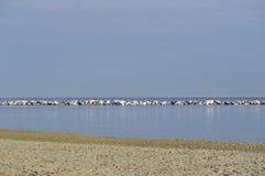 Wave Breaker. On Rimini coast stock photos