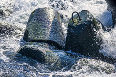 Wave-breaker with spindrift Royalty Free Stock Photography