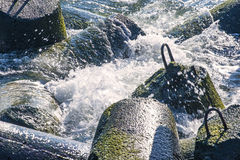 Wave-breaker with spindrift Royalty Free Stock Images
