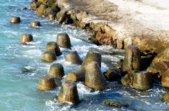 Wave breaker tetrapods stock images