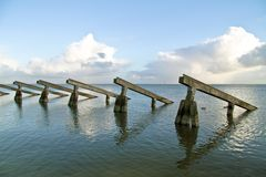 Wave breakers in the IJsselmeer in the Netherlands. With a beautiful cloudscape Royalty Free Stock Photography