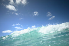 Wave breaking. With blue sky stock photo