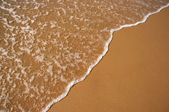 Wave breaking on a beach Stock Photography