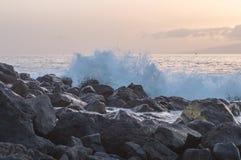 Wave breaking on big stones of Tenerife island coast Royalty Free Stock Photo