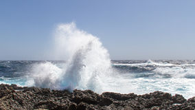 Wave breaking at the coast Stock Photo