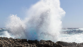 Wave breaking at the coast. A storm sends sunlit waves splashing on the Mediterranean coast of Gozo Malta Stock Photo