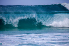 Wave breaking. Breaking wave creating a tube with crystal clear blue water Royalty Free Stock Photos