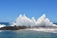 Wave breaking on a harbour Royalty Free Stock Image