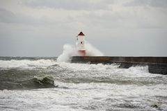 Wave breaking over lighthouse, Berwick upon Tweed Royalty Free Stock Photo