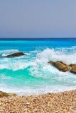 Wave breaking at seashore Stock Photo