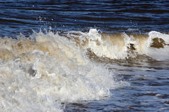 Wave breaking on seashore at Fleetwood Lancashire Royalty Free Stock Images