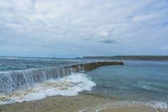 Wave breaking on Sennen cove fishing harbor breakwater Royalty Free Stock Image
