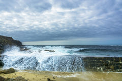 Wave breaking on Sennen cove fishing harbor breakwater Royalty Free Stock Photography