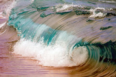 Wave breaking on shoreline. Stock Photos