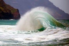 Wave breaking on shoreline. Stock Images